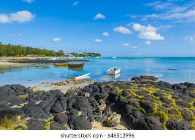 Mauritius - Bain Boeuf tropical beach with yachts and fishing boats