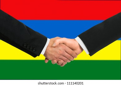 The Mauritius flag and business handshake