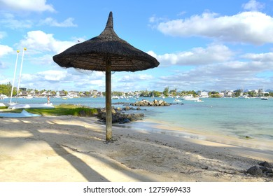 Mauritius , grand baie - august 2019 : view on the heavenly beach with hotels and tourists