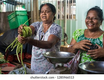 Mauritius Island, 07.01.2019: Locals in the rural market of Mauritius, selling fresh vegetables.