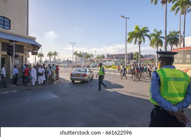 MAURITIUS, MAY 22, 2017. Police guiding the traffic in an intersection in the center of Port Louis, in Mauritius on May 22nd 2017.