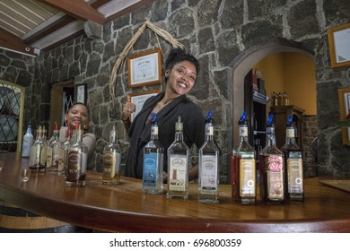 MAURITIUS, MAY 24, 2017. Beautiful waitresses introducing different kinds of rum made of sugar cane in the rum distillery of St. Aubin colonial house in Mauritius on May 24th 2017.