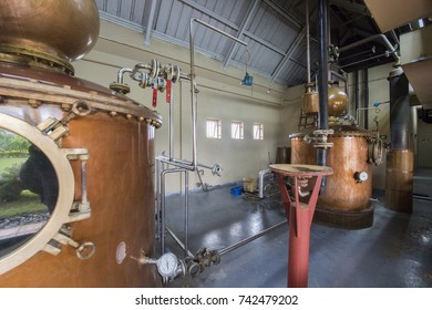 MAURITIUS, MAY 31, 2017. Old rum distilling machines for making rum from sugar cane in Chamarel rum distillery and factory Outlet in Mauritius on May 31st 2017.