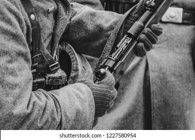 Mauser rifle in the hands of the Wehrmacht soldier World War II, the bolt is cocked. Black and white shot