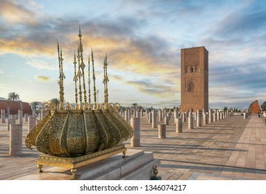 The Mausoleum of Mohammed V is a historical building located on the opposite side of the Hassan Tower on the Yacoub al-Mansour esplanade in the capital city of Rabat, Morocco at sunset.