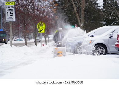 Mauston, Wisconsin USA - January 19th, 2021: Local people snow blowing their properties after a heavy snowfall.