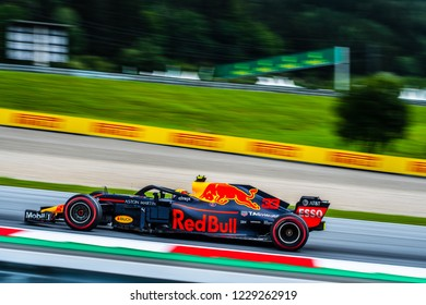 Max Verstappen (NDL) screaming past up the hill in the Austrian mountains in his Red Bull RB14 during FP1 ahead of the 2018 Austrian Grand Prix at the Red Bull Ring.