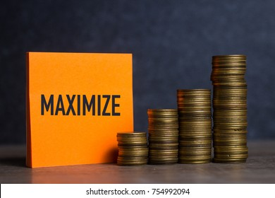 Maximize text on orange note paper, money coin stacks of growth on wood table