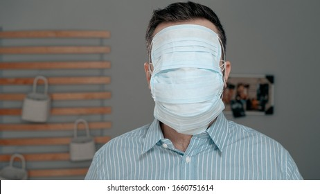 Maximum protection for cold, flu, virus, acute respiratory infections, quarantine, epidemic, irony, sarcasm concept. Tired sick man puts on surgical mask, then one more and one more ...