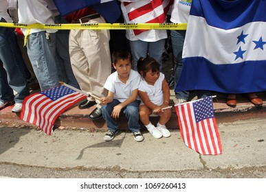 May 01, 2006; Los Angeles, CA, USA; Two Mexican children wave American flags during an immigrant in Los Angeles, California. During  'A Day Without an Immigrant' .