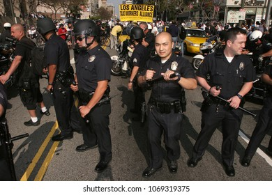 May 01, 2006; Los Angeles, CA, USA; Police surround several Taxi Cabs and force them out of a immigrant march in Los Angeles, California. During 'A Day Without an Immigrant'.