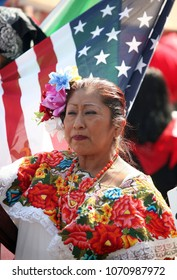 May 01, 2008 - Los Angeles, California, USA - A Mexican woman joins thousands of people rallying during three May Day immigration marches in Los Angeles, to bring attention to immigration reform.