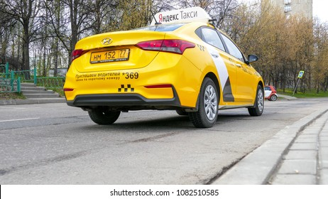MAY 02, 2018 MOSCOW, RUSSIA: Yellow taxi car on the road. Yandex taxi is the biggest car service aggregator in Russia.