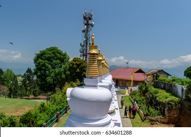 May 02,2017.White stupa in Zang Dhok Palri Phodang  a Buddhist monastery in Kalimpong in West Bengal, India. and blue sky with clouds in the background .