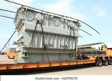 MAY 1, 2016 : UDON THANI - THAILAND : Under loading heavy power transformer with heavy truck at site to be installed in high voltage station