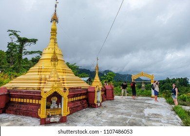 May 1 2018 - Myeik Archipelago. Tourists visiting a pagoda on a hill above a Moken village