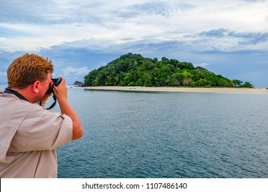 May 1 2018 - Myeik Archipelago. Photographer taking a picture of a deserted island in the archipelago.