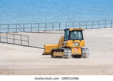 May 1 2018 Warren Dunes State par Bridgman MI USA; beach clean up with a bulldozer helps move sand back to the beach where it belongs