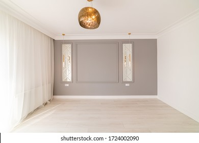 May 1, 2020, the city of Uzhhorod. The room of the house in light colors with a gray wall and modern LED lighting with a light floor. Designer renovation for a young family