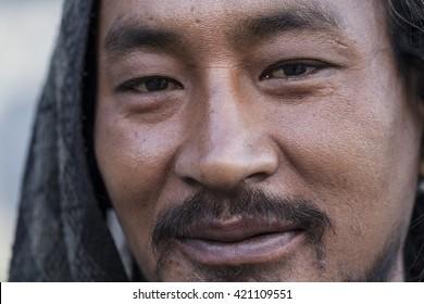MAY 10, 2014 - HIMALAYAS, NEPAL: Close up macro portrait of an unidentified Nepalese man photographed near Annapurna mountain in Himalayas, Nepal