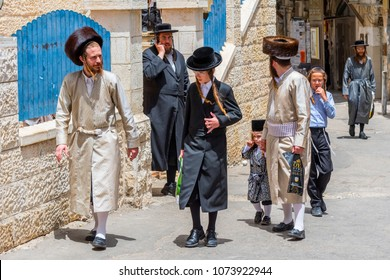 May 10, 2017. A traditional orthodox Judaic family with the child on the Mea Shearin street in Jerusalem, Israel.
