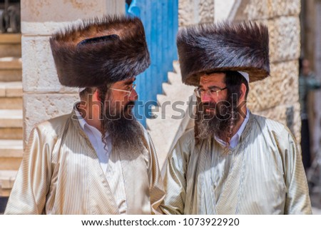 May 10, 2017. Two orthodox Jewish men walking on the street in Mea Shearin district, Jerusalem, Israel.