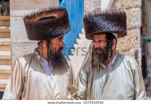May 10, 2017. Two orthodox Jewish men walking on the street in Mea Shearin district, Jerusalem, Israel.