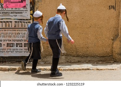 May 10, 2017. Ultra orthodox jewish boys walking on the street in Mea shearim Jewish Orthodox quarter, Israel Jerusalem.
