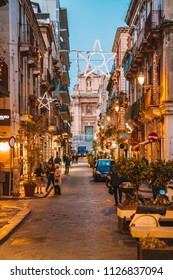 May 10, 2018. Catania, Sicily. Narrow cosy night streets in the old European town with small shops and cafes.