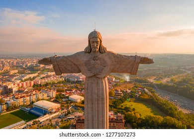 May 10, 2018. Lisbon, Portugal. View of Christ the King Statue near 25th of April Bridge in Lisbon, Portugal
