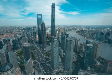 MAY 10, 2019: Aerial view over Shanghai's tallest skyscrapers: Jin Mao Tower, Shanghai tower and Shanghai World Financial Center and Huangpu River. Pudong. Shanghai. China