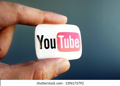 May 10 2019, Kyiv Ukraine. Video blogger holds YouTube logo.