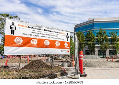 May 10, 2020 Sunnyvale / CA / USA - Social Distancing rules meant to protect against the transmission of COVID-19, in English and Spanish, displayed at the entrance to a commercial construction site;