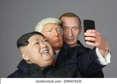 MAY 11 2018: Caricatures of US President Donald Trump taking as selfie with North Korean Supreme Leader Kim Jong Un and Russian President Vladimir Putin