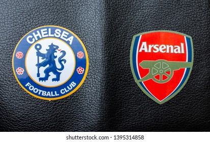 May 11, 2019 Baku, Azerbaijan. Emblems of the finalists of the UEFA Europa League season 2018/2019 of FC Arsenal (London) and FC Chelsea (London) on a black koan background.