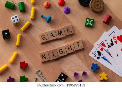"May 11, 2019: Vancouver, B.C. Canada (Editorial) - Scrabble Word Tiles Spelling ""Game Night"" with other game pieces around it - Image"