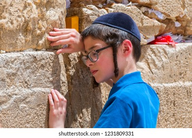 May 12, 2017. Young boy praying at the Western wall in Jerusalem old city, Israel.