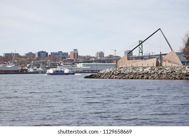 May 12, 2018 - Dartmouth, Nova Scotia: Looking at the Alderney Landing on the Dartmouth waterfront with a ferry crossing and naval shipyard in the background