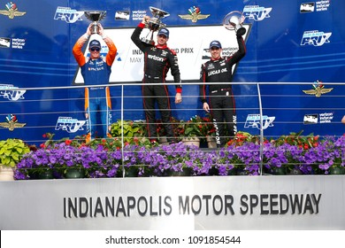 May 12, 2018 - Indianapolis, Indiana, USA: WILL POWER (12) of Australia, SCOTT DIXON (9) of New Zealand, and ROBERT WICKENS (6) of Canada celebrate after finishing 1 - 2 - 3  in the IndyCar Grand Prix