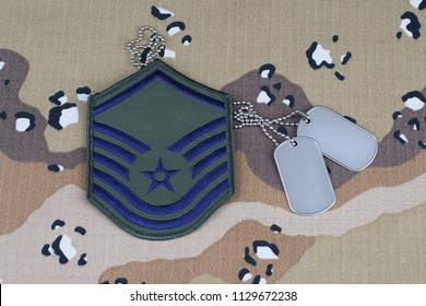 May 12, 2018. US AIR FORCE Master Sergeant rank patch and dog tags on desert camouflage uniform