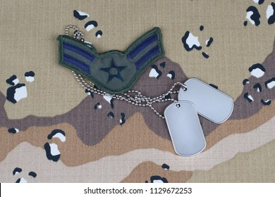 May 12, 2018. US AIR FORCE Airman First Class rank patch and dog tags on desert camouflage uniform