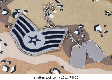 May 12, 2018. US AIR FORCE Staff Sergeant rank patch and dog tags on Desert Battle Dress Uniform
