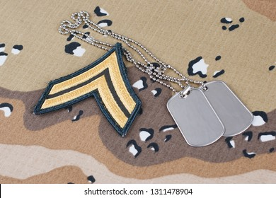 May 12, 2018. US ARMY Corporal rank patch and dog tags on Desert Battle Dress Uniform