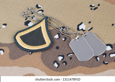 May 12, 2018. US ARMY Private First Class rank patch and dog tags on Desert Battle Dress Uniform