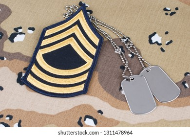 May 12, 2018. US ARMY Master Sergeant rank patch and dog tags on Desert Battle Dress Uniform