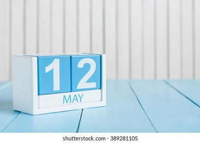 May 12th. Image of may 12 wooden color calendar on white background.  Spring day, empty space for text. International Nurses Day
