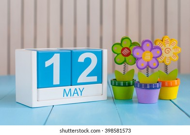 May 12th. Image of may 12 wooden color calendar on white background with flowers. Spring day, empty space for text. International Nurses Day