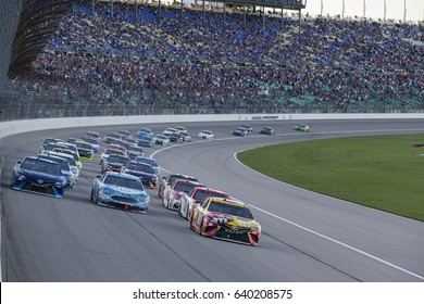 May 13, 2017 - Kansas City, Kansas, USA: Kyle Busch (18), Kevin Harvick (4) and Martin Truex Jr. (78) race for the lead during the Go Bowling 400 at Kansas Speedway.