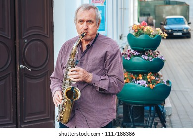 May 13, 2018 Minsk Belarus Street walks A man plays the saxophone on the street