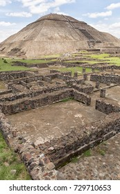 May 15, 2014 Teotihuacan, Mexico: ancient Aztec ruin structures with the Pyramid of the Sun in the background at the Teotihucan archaeologic site